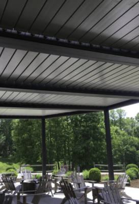 Rich Tones and Textures Warm Up This Patio in Auston, TX Featuring a Modern Louvered Roof System